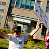 "Terry Frazier, of Broomfield, yells while protesting in front of Bank of America near Canyon Boulevard and 26th Street in Boulder on Friday, Oct. 14. For more photos of the game go to  <a href=""http://www.dailycamera.com"">http://www.dailycamera.com</a><br /> Jeremy Papasso/ Camera"