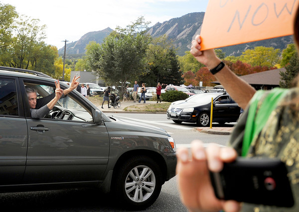 "on Saturday, Oct. 15, during the ""Occupy Boulder"" rally near the intersection of Canyon Boulevard and Broadway in Boulder. For more photos and a video of the rally go to  <a href=""http://www.dailycamera.com"">http://www.dailycamera.com</a><br /> Jeremy Papasso/ Camera"
