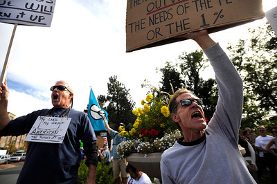 "Hal Buggy, left, of Boulder, and Mark VanderLugt, also of Boulder, chant ""We Are The 99 Percent"" while protesting on Saturday, Oct. 15, during the ""Occupy Boulder"" rally near the intersection of Canyon Boulevard and Broadway in Boulder. For more photos and a video of the rally go to www.dailycamera.com Jeremy Papasso/ Camera"
