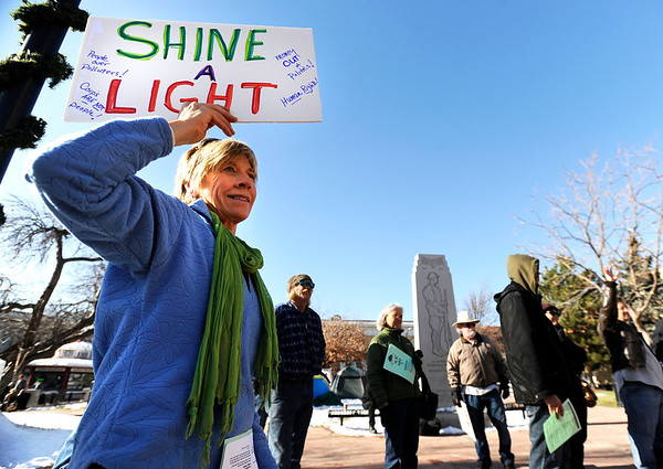"""A woman who asked to be identified as Ginger Riversong during an Occupy Boulder Rally on Saturday, Dec. 10, in downtown Boulder. For more photos and video of the rally go to  <a href=""""http://www.dailycamera.com"""">http://www.dailycamera.com</a><br /> Jeremy Papasso/ Camera"""
