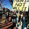 "Carolyn Bninski, of Boulder, right, marches with a rally sign during an Occupy Boulder Rally on Saturday, Dec. 10, in downtown Boulder. For more photos and video of the rally go to  <a href=""http://www.dailycamera.com"">http://www.dailycamera.com</a><br /> Jeremy Papasso/ Camera"