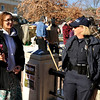 "Anna Suppe, Longmont, left, shares a laugh with Boulder Police Officer Paddock during an Occupy Boulder Rally on Saturday, Dec. 10, in downtown Boulder. For more photos and video of the rally go to  <a href=""http://www.dailycamera.com"">http://www.dailycamera.com</a><br /> Jeremy Papasso/ Camera"