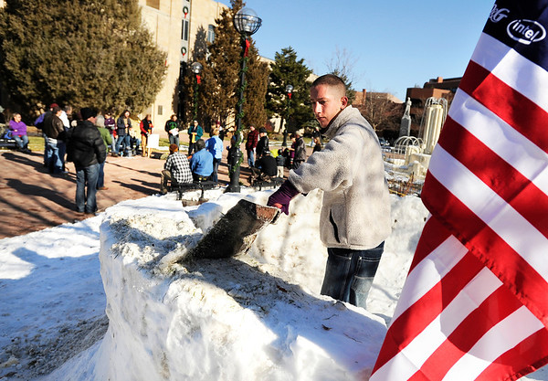 """Cyler Hardin works on building a snow fort at the Occupy Boulder campsite during an Occupy Boulder Rally on Saturday, Dec. 10, in downtown Boulder. For more photos and video of the rally go to  <a href=""""http://www.dailycamera.com"""">http://www.dailycamera.com</a><br /> Jeremy Papasso/ Camera"""