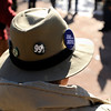 "A man wearing a 99% pin on his hat sits on a bench during an Occupy Boulder Rally on Saturday, Dec. 10, in downtown Boulder. For more photos and video of the rally go to  <a href=""http://www.dailycamera.com"">http://www.dailycamera.com</a><br /> Jeremy Papasso/ Camera"
