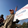 "Ward Anthony, of Boulder, right, holds a sign while listening to a speaker during an Occupy Boulder rally on Saturday, Nov. 26, in front of the Boulder County Courthouse on the Pearl Street Mall in Boulder. For more photos and video of the rally go to  <a href=""http://www.dailycamera.com"">http://www.dailycamera.com</a><br /> Jeremy Papasso/ Camera"