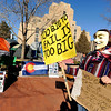 "Sean Malcolm, 15, of Boulder, walks down Pearl Street with his signs during an Occupy Boulder rally on Saturday, Nov. 26, in front of the Boulder County Courthouse on the Pearl Street Mall in Boulder. For more photos and video of the rally go to  <a href=""http://www.dailycamera.com"">http://www.dailycamera.com</a><br /> Jeremy Papasso/ Camera"