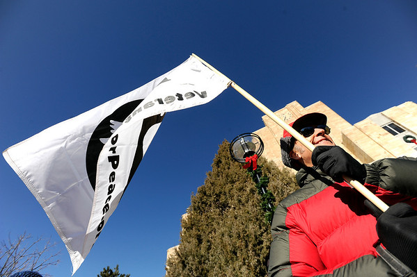 """George Newell, of Boulder, holds a Veterans for Peace flag during an Occupy Boulder rally on Saturday, Nov. 26, in front of the Boulder County Courthouse on the Pearl Street Mall in Boulder. For more photos and video of the rally go to  <a href=""""http://www.dailycamera.com"""">http://www.dailycamera.com</a><br /> Jeremy Papasso/ Camera"""