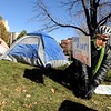 "A woman who asked to be identified as Ginger Riversong, of Boulder, places a sign in front of the Occupy Boulder campers during an Occupy Boulder rally on Saturday, Nov. 26, in front of the Boulder County Courthouse on the Pearl Street Mall in Boulder. For more photos and video of the rally go to  <a href=""http://www.dailycamera.com"">http://www.dailycamera.com</a><br /> Jeremy Papasso/ Camera"