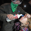Occupy Ports Seattle.JP(4).JPG A protestor is treated after being pepper sprayed by police officers MOnday Dec . 12, 2011 in Seattle. Protestors  tried to prevent cars and trucks from entering the Port of Seattle's Terminal 18 late Monday afternoon,  as part of the Occupy the Port rallies on the West Coast.  (AP Photo/Ellen M. Banner / The Seattle Times) OUTS: SEATTLE OUT, USA TODAY OUT, MAGAZINES OUT, TELEVISION OUT, SALES OUT. MANDATORY CREDIT TO: Ellen M. Banner /THE SEATTLE TIMES.