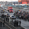 Occupy Ports Seattle.JP(3).JPG Protestors block one lane of traffic at the entrance to Terminal 18 on Klickitat Avenue SW, in Seattle Monday afternoon, Dec. 12, 2011 as part of the Occupy the Ports rallies up and down the West Coast.    From Long Beach, Calif., to as far away as Anchorage, Alaska, and Vancouver, British Columbia, protesters beat drums and carried signs as they marched outside port gates.  (AP Photo/Ellen M. Banner / The Seattle Times) OUTS: SEATTLE OUT, USA TODAY OUT, MAGAZINES OUT, TELEVISION OUT, SALES OUT. MANDATORY CREDIT TO: Ellen M. Banner /THE SEATTLE TIMES.