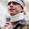 Occupy Ports.JPEG-03518.JPG Injured veteran Scott Olsen speaks during a protestors rally at Frank Ogawa Plaza, Monday, Dec. 12, 2011, in Oakland, Calif. (AP Photo/Beck Diefenbach)