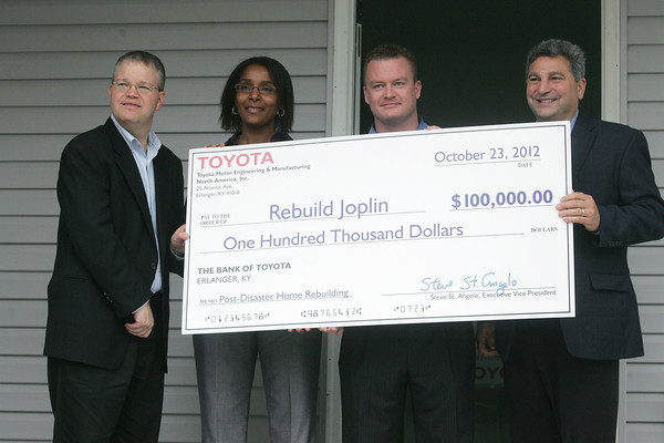 Globe/Roger Nomer<br /> (from left) Jamie Bonini, general manager with Toyota Production System Support Center, Inc., Joplin Mayor Melodee Colbert-Kean, Jerrod Hogan, co-founder of Rebuild Joplin, and Steve St. Angelo, executive vice-president of Toyota Motor Engineering and Manufacturing North America, Inc., announce a gift of $100,000 from Toyota to Rebuild Joplin on Tuesday morning.