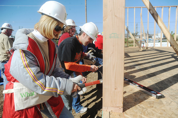 Globe/Roger Nomer<br /> Sue Metz and Travis Kunce hammer a wall at the 2630 Wall habitat site on Monday, Oct. 8, 2012.  Kunce is the son of the family getting the new home.