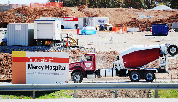 Globe/T. Rob Brown<br /> A cement truck makes a delivery as construction continues Thursday afternoon, Oct. 18, 2012, at the new Mercy hospital.