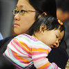 Globe/T. Rob Brown<br /> Seven-month-old Sonja Wiyogo takes a nap on the shoulder of her mother, Octarina Lautdjaja Oct. 12, 2012, during a naturalization ceremony at George Washington Carver National Monument. Lautdjaja, who is originally from Indonesia, is now a U.S. citizen. Wiyogo, who was born in the United States was already a citizen.