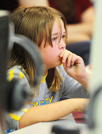 Globe/T. Rob Brown<br /> Alex Beaunoyer, a fifth grader at Columbia Elementary School, reads Internet information at the University of Arkansas Wednesday afternoon, Oct. 24, 2012, during Eagle Time where she worked on her independent research project on the university.