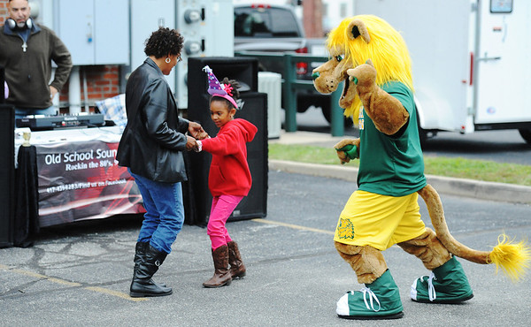 Globe/T. Rob Brown<br /> Mayor Melodee Colbert-Kean dances with her six-year-old daughter Alissa Kean and the Missouri Southern State University mascot Tuesday afternoon, Oct. 9, 2012, during the 95th anniversary party for the Joplin Area Chamber of Commerce, outside the chamber's offices.