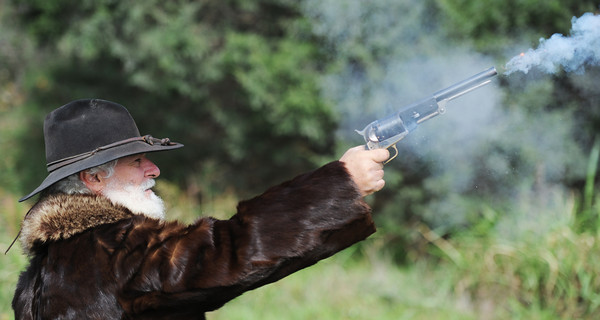 Globe/T. Rob Brown<br /> Brett Dawson of Fort Scott, Kan., fires an 1847 Colt Walker (.44 caliber pistol), possibly the largest hand gun ever made, during a demonstration for Pittsburg, Kan., elementary school students Friday afternoon, Oct. 26, 2012. Dawson is a member of the Border Creek Raiders re-enactment group from Fort Scott.