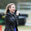 Globe/Roger Nomer<br /> Giana Epps, 12, Overland Park, sings the National Anthem before NEO's homecoming football game on Saturday afternoon.  Epps's father, grandfather and great uncle all played football for the Norsemen.