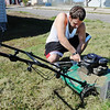 Globe/T. Rob Brown<br /> Zack Short, of Joplin, repairs his lawnmower as he attempts to finish what might be the last mowing of the year Wednesday afternoon near the intersection of 25th Street and South Empire Avenue.