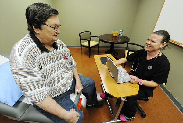 Globe/T. Rob Brown<br /> Patient Bill Paapanen, of Joplin, is evaluated by nurse Brooke McCully, LPN, Monday afternoon, Oct. 1, 2012, during the grand re-opening of the Freeman Center for Geriatric Medicine, 931 E. 32nd St., Joplin. The facility recently expanded, doubling its number of patient rooms, and added an infusion center (where medicine can be administered via IV or to help patients with hydration).