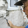 Globe/T. Rob Brown<br /> L.A. Matthews, of Joplin, volunteer with Rebuild Joplin, applies structure patch around a new window for a Joplin home at 1016 W. 19th St.