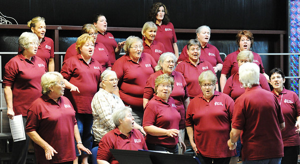 Globe/T. Rob Brown<br /> Singers sing.