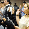Globe/T. Rob Brown<br /> Sara Aponte, right, is sworn in with 39 other new U.S. citizens Oct. 12, 2012, during a naturalization ceremony at George Washington Carver National Monument.