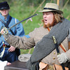 Globe/T. Rob Brown<br /> Matthew Wells of Fort Scott, Kan., explains why Civil War-era cavalry used curved sabers rather than straight blades during a demonstration for Pittsburg, Kan., elementary school students Friday afternoon, Oct. 26, 2012, at Cato, Kan. Wells, who is a member of the Border Creek Raiders re-enactment group from Fort Scott, said while riding horseback the impact of swinging a straight blade could damage the wielder's hand whereas the saber helped prevent that problem.