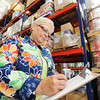 Globe/T. Rob Brown<br /> Sue Jarvi, a tornado volunteer from Illinois, works in a large warehouse Thursday morning, Oct. 18, 2012, in Joplin. The warehouse contains items for tornado victims and rebuilding efforts.