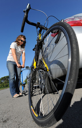 Globe/T. Rob Brown<br /> Ruth Sawkins, of Joplin airs up the back tire on her bicycle Wednesday morning, Oct. 3, 2012, near the intersection of Murphy Boulevard and Campbell Parkway. Sawkins is part of the Look campaign and its Share the Road program, encouraging motorists to be more aware of bicyclists, runners and walkers.