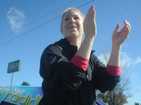 Globe/Roger Nomer<br /> Hillary Holcomb, New York, cheers on her husband Mark as he finish the full marathon at the Mother Road Marathon on Sunday.