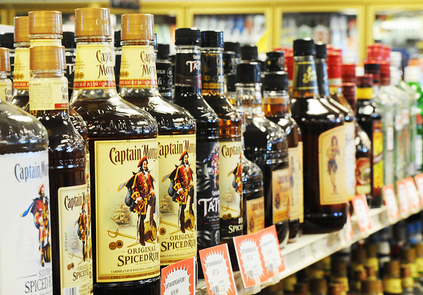 Globe/T. Rob Brown<br /> A variety of rum on the shelves of The Jug Store Liquors Tuesday afternoon, Oct. 9, 2012, at the convenience and liquor store located just north of the Arkansas border on 71 Highway.