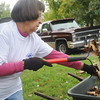 Globe/Roger Nomer<br /> Betty Saltenberger, Joplin, rakes leaves at 115 N. Patterson during Saturday's Hearts and Hammers event.