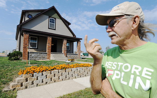 Globe/T. Rob Brown<br /> Dan Farren, of Joplin, talks about his home at 2206 S. Kentucky Ave., as being tested by the county back in February and having soil remediation done by the city in May, in front of his yard Thursday afternoon, Oct. 4, 2012.