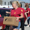 Globe/T. Rob Brown<br /> Angie Getso, of Springfield, a volunteer from Bass Pro Shops corporate office in Springfield, carries a box from Feed the Children and Convoy of Hope to a Joplin family Wednesday morning, Oct. 3, 2012, just off Maiden Lane, near 7th Street, in Joplin.