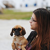 Globe/T. Rob Brown<br /> Tiffany Whittington, holds one of the family dogs, a puggle named Gigi, as she walks down a street in the FEMA mobile home park near the Joplin Regional Airport, Tuesday afternoon, Oct. 9, 2012.