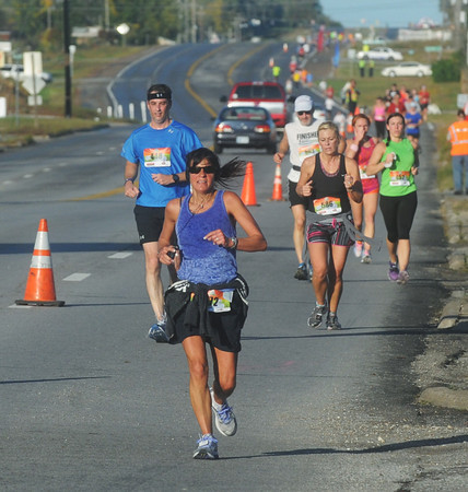 Globe/Roger Nomer<br /> Runners make their way down Route 66 in Galena during the Mother Road Marathon on Sunday.