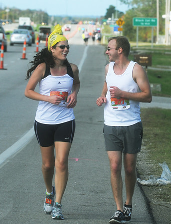 Globe/Roger Nomer<br /> Hannah and Cody Garvin, Baxter Springs, finish the half marathon together during Sunday's Mother Road Marathon.
