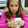 Globe/T. Rob Brown<br /> Six-year-old Tailey Webb of Seneca creates a Halloween mummy during arts and crafts Thursday morning, Oct. 25, 2012, at the library in Seneca.
