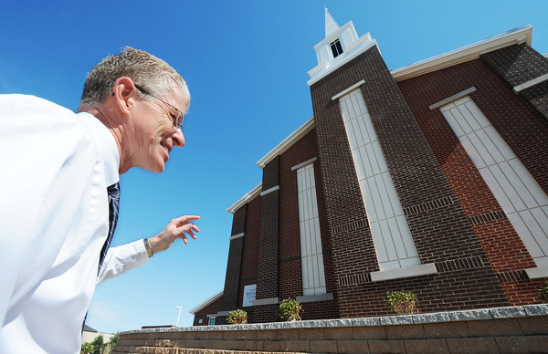 Globe/T. Rob Brown<br /> Creed Jones, Stake president in Joplin, talks about the improvements that shaped the rebuilt Church of Jesus Christ of Latter Day Saints (LDS) Monday afternoon, Oct. 15, 2012, in front of the church. The Joplin church, located across the street from Joplin High School, was destroyed during the May 22, 2011, tornado.