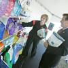 Globe/Roger Nomer<br /> Stephanie Rarick helps Mike Downing, deputy director of the Missouri Department of Economic Development, select a bag of Blue Buffalo dog food on Tuesday.