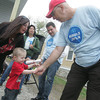 Globe/Roger Nomer<br /> Tara Johnston and grandson Braydon Long, 2, shake hands with Tim Limkeman, a site supervisor with Rebuild Joplin, on Tuesday morning.  Limkeman helped with the texturing on Johnston's new walls.