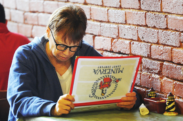 Globe/T. Rob Brown<br /> Customer Jane Platt of Carthage reads over the Minerva Candy Company menu as she prepares to order lunch Thursday, Oct. 25, 2012, during the grand re-opening of the remodeled downtown Webb City business.