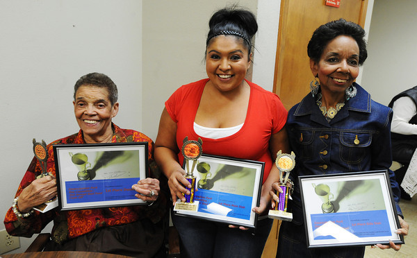 Globe/T. Rob Brown<br /> Winners of the Soul Food Cookoff, from left, are: Louise West, first-place dessert for her jelly cake; Anita Simmons, first-place main course for her fried chicken; and Janice Booth, first-place side dish for her collard greens.