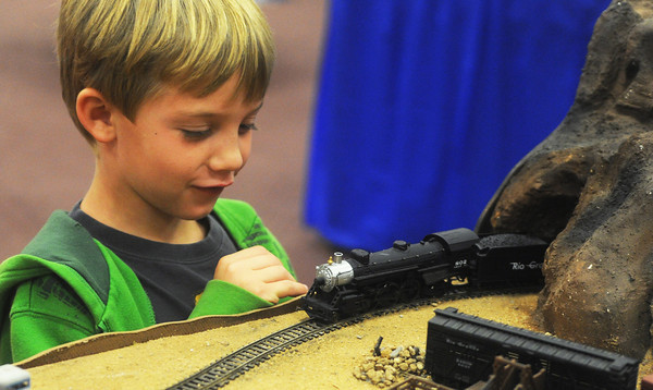 Globe/Roger Nomer<br /> Skyler Kendall, 7, watches the progress of a model train while visiting the Model Railroad Show and Swap Meet sponsored by the Southwest Missouri Railroad Association at Fairview Christian Church in Carthage on Saturday morning.