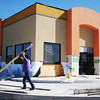 Globe/T. Rob Brown<br /> Part of a construction crew from subcontractor Commercial Systems, works on the exterior of the nearly rebuilt Taco Bell on South Main Street Thursday afternoon, Oct. 18, 2012, in Joplin.