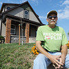 Globe/T. Rob Brown<br /> Dan Farren, of Joplin, sits outside his 2206 S. Kentucky Ave. home, Thursday afternoon, Oct. 4, 2012. His Joplin home was tested by the county back in February and soil remediation was done by the city in May.