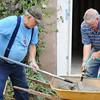 Globe/T. Rob Brown<br /> L.A. Matthews, left, of Joplin, and Wayne Myers, of Bridgeton, volunteers with Rebuild Joplin, mix cement for a Joplin home at 1016 W. 19th St.