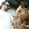 Globe/Roger Nomer<br /> John Brummet pets Pete, one of the horses used for therapy at Magic Moments on Wednesday evening.